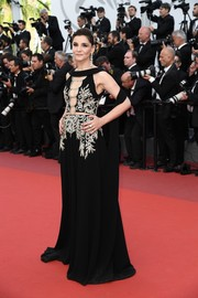 Clotilde Courau went for sultry glamour in a black cutout gown with gold embroidery at the Cannes Film Festival screening of 'The Meyerowitz Stories.'