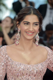 Sonam Kapoor styled her hair into a center-parted chignon for the Cannes Film Festival screening of 'The Meyerowitz Stories.'
