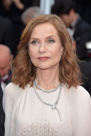 Isabelle Huppert accessorized with a gorgeous Bulgari Serpenti necklace.