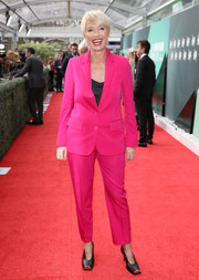 Emma Thompson was hard to miss in her hot-pink Stella McCartney suit at the UK premiere of 'The Meyerowitz Stories.'