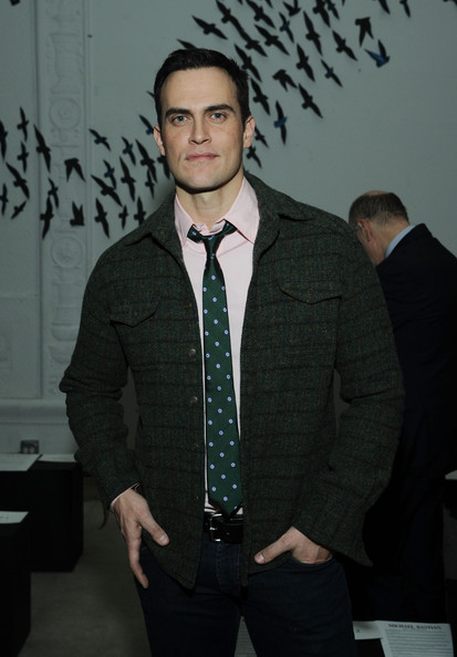 Cheyenne Jackson's green dotted tie simply popped when paired with a light pink button-down shirt and forest green blazer.