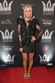 Ashlee Simpson complemented her frock with black ankle-strap sandals by Giuseppe Zanotti.