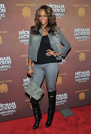 Knee-high black boots broke up Tyra's gray-on-gray denim look.