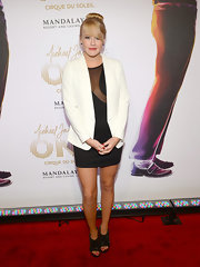 Carrie St. Louis topped off her LBD with an oversized white blazer at the 'Michel Jackson ONE by Cirque du Soleil' premiere.