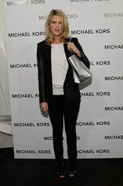 Alexandra Richards spiced up her black and white look with a basic blazer with leather arm sleeves at the Michael Kors Fall 2013 runway show.