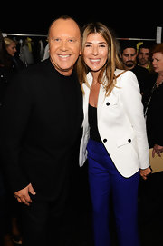 Nina Garcia attended the Michael Kors Spring 2013 fashion show looking smart in a white blazer and blue pants.