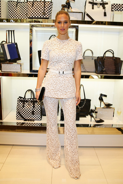 Bar Refaeli looked classic in a fitted white lace blouse by Michael Kors during the designer's Milano cocktail party.