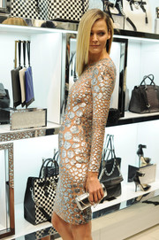 Carmen Kass was a stunner at the Michael Kors Milano cocktail party with this metallic python purse and cocktail dress combo, both by Michael Kors.