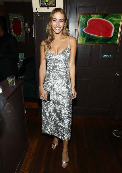 Harley Viera-Newton complemented her dress with a silver box clutch.