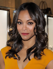 Zoe Saldana wore her shiny tresses in soft curls at the opening of a Michael Kors boutique in Los Angeles.