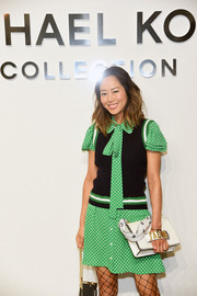Aimee Song attended the Michael Kors fashion show carrying a white hand-strap clutch by Dior.
