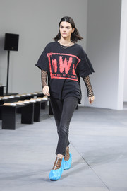 Kendall Jenner kept it relaxed in a 'New World Order' tee while rehearsing for the Michael Kors fashion show.
