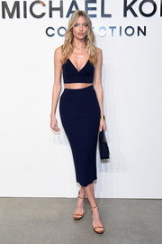 Martha Hunt turned up the heat in a plunging navy crop-top at the Michael Kors fashion show.