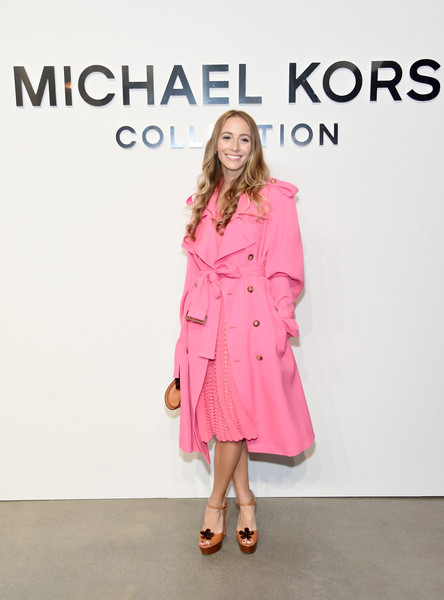 Harley Viera-Newton was a cutie at the Michael Kors fashion show in a Barbie-pink trenchcoat from the label.