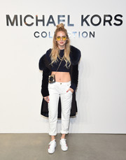Chiara Ferragni hit the Michael Kors fashion show rocking a navy crop-top.