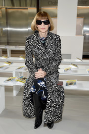 Anna Wintour mixed prints like a pro with this zebra coat and floral dress combo at the Michael Kors fashion show.
