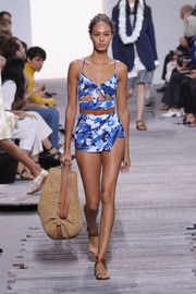 Joan Smalls walked the Michael Kors runway wearing a blue floral one-piece with a midriff cutout.