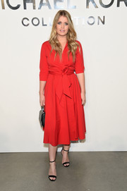 Kitty Spencer looked effortlessly chic in a red wrap dress at the Michael Kors Spring 2018 show.