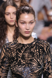 Bella Hadid was fresh-faced with her hair pulled back into a knot at the Michael Kors runway show.