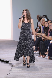 Sara Bareilles styled her dress with black crisscross-strap sandals.
