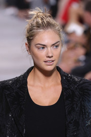 Kate Upton rocked a messy bun on the Michael Kors runway.