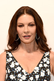Catherine Zeta-Jones sported a feathery center-parted hairstyle at the Michael Kors Spring 2019 show.