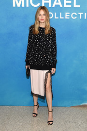 A Michael Kors slip skirt, in pale pink with black lace trim, finished off Halston Sage's outfit.