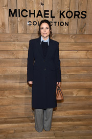 Julia Louis-Dreyfus was menswear-chic in a navy coat and gray trousers at the Michael Kors Fall 2020 show.
