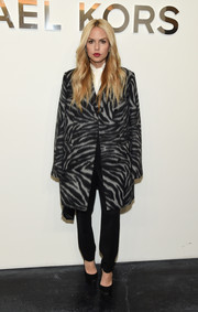 Rachel Zoe was all business in a zebra-print coat and black slacks at the Michael Kors fashion show.