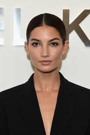 Lily Aldridge went for simple elegance with this tight, center-parted bun at the Michael Kors fashion show.