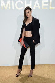 Jacquelyn Jablonski styled her outfit with a two-tone leather clutch by Michael Kors.