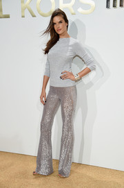 Alessandra Ambrosio kept it laid-back yet chic in a silver Michael Kors sweater during the label's fragrance launch.