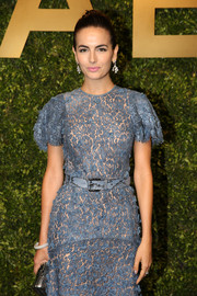 Camilla Belle attended the Michael Kors Jet Set Experience event wearing a blue lace dress cinched at the waist with a python belt.