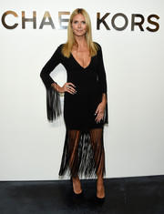Heidi Klum went for a flirty-hippie look with this fringed LBD by Michael Kors during the label's fashion show.