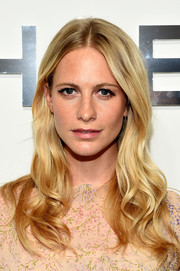 Poppy Delevingne wore her hair loose with a center part and sweet waves during the Michael Kors fashion show.