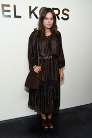 Atlanta de Cadenet completed her conservative ensemble with a brown suede shoulder bag.