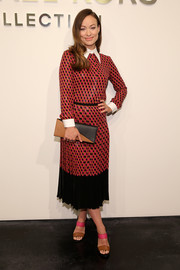 For her bag, Olivia Wilde picked a tan and black Michael Kors leather clutch.