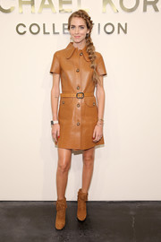 Chiara Ferragni completed her monochromatic-chic look with tan suede lace-up boots.