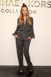 Amber Le Bon was business-chic in a long-sleeve paisley-print jumpsuit during the Michael Kors fashion show.