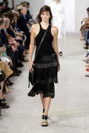 Kendall Jenner walked the Michael Kors runway in an LBD with an oversized belt and leather tote.