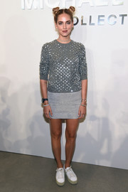 Chiara Ferragni was cute and put-together in her embellished grey sweater that she paired with a light grey mini skirt at the Michael Kors Spring 2017 show.