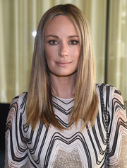 Catt Sadler looked glam with a shiny and sleek straight cut that showed off her layers while attending the Michael Kors Spring 2017 show.