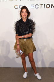 Leandra Medine wore an eclectic black fringed top with sequined details at the Michael Kors Spring 2017 show.