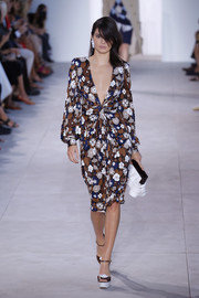 Kendall Jenner was equal parts sweet and sexy in this cleavage-flaunting floral dress at the Michael Kors runway show.