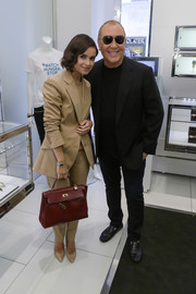 Miroslava Duma completed her classy look with a red Hermes Kelly.