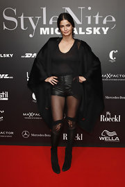 Shermine Shahrivar mixed different fabrics at the Michalsky StyleNite as she matched her sheer top with leather shorts and topped it with a silk robe.