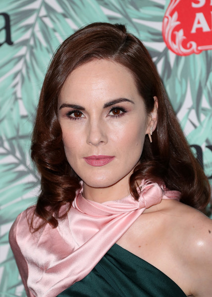 Michelle Dockery Dangling Diamond Earrings [hair,face,hairstyle,eyebrow,beauty,lip,skin,chin,long hair,forehead,michelle dockery,women in film pre-oscar cocktail party,arrivals,california,los angeles,nightingale plaza,10th annual women in film pre-oscar cocktail party]