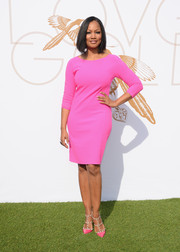 Garcelle Beauvais brightened up the LoveGold luncheon with her neon-pink sweater dress.