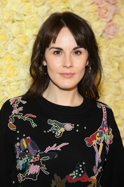 Michelle Dockery Long Wavy Cut with Bangs [haute couture spring summer,hair,hairstyle,beauty,lady,black hair,neck,long hair,t-shirt,brown hair,smile,schiaparelli,michelle dockery,front row,part,schiaparelli haute couture spring summer 2019,paris,france,paris fashion week,show]