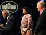 Michelle Obama charmed in a retro floral skirt suit during an anti-obesity campaign event at the White House.